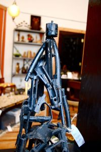 A sculpture made out of recycled gun parts